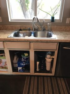 Remove cabinet doors and clean out cabinets